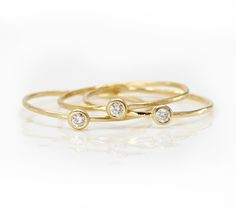 TINY WHITE DIAMOND STACKING RING IN 14K YELLOW GOLD