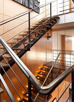 According to the Feng Shui rules, stairs need to be well lit, just like the stairs in this NYC penthouse.