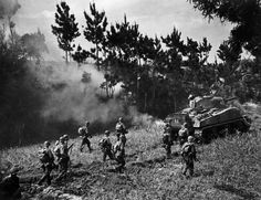 W. Eugene  Smith  The Pacific Campaign. April 1945. The Battle of Okinawa (Japanese island).   US troops advancing under the protection of tanks. (rw)