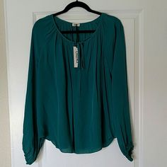 SALE! L'AGENCE tie-neck peasant blouse, NWT, 4 L'AGENCE tie-neck peasant blouse, size 4. 100% silk. Gorgeous teal color. New with tags. L'AGENCE Tops Blouses
