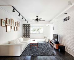 There is something about white brick wall ideas that I really like. No matter what kind of space it is, I like to see a brick wall no matter how small that area is Living Room Themes, Living Room Interior, Living Room Designs, Track Lights Living Room, Living Room Lighting, Narrow Living Room, Living Room White, Rectangle Living Rooms, Home Design