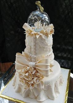 Ivory Wedding Cake inspired by Bride's Dress with Unique Glass Topper