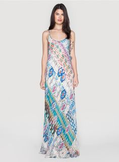 Blossom Mix Dress The Johnny Was BLOSSOM MIX DRESS features a stunning scattered Aztec-inspired print in cream, blue, turquoise, and magenta hues. Pair this printed maxi dress with a vintage leather belt and wide-brimmed hat for the ultimate bohemian summer look!  - Printed Rayon Georgette - Slip Included - Adjustable Spaghetti Straps, Scoop Neckline, Maxi Skirt - Signature Print - Care Instructions: Machine Wash Cold, Tumble Dry Low
