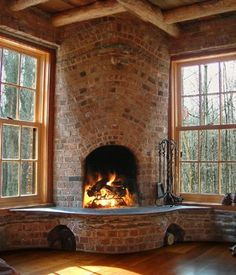 Charming brick arched fireplace
