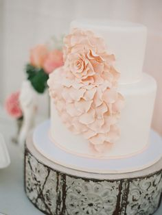 pink flower cake on our vintage tile cake stand Inspiration   Pretty Vintage Rentals