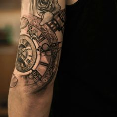 Timepiece and flower tattoo