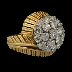 Cartier, Paris c1950s - Striking ring designed as a cluster of brilliant-cut diamonds, set in a pierced yellow gold mount of stylised fern leaf design.