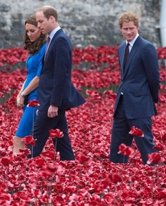 Catherine, Duchess of Cambridge, Prince William, Duke of Cambridge and Prince Harry visit The Tower Of London's Ceramic Poppy Field installation 'Blood Swept Lands and Seas of Red', commemorating the 100th anniversary of the outbreak of First World War, 05.08.2014 in London, England.