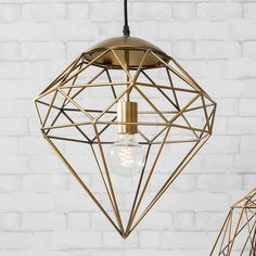 """Chic diamond shaped cage light in a light gold finishThe stunning, geometric inspired Eldon Pendant Light looks stunning hung up in any room of the house. A super stylish piece that will add class and pizazz to any home. Industrial in style, can't you just see this as the centre piece of a warehouse apartment or a modern twist to a classic home? Light bulb not included.Metal.16"""" x 16"""""""