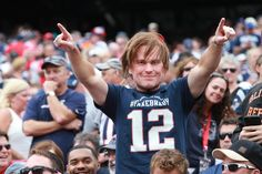 The Patriots fan wearing a Tom Brady mask was former player Wes Welker.