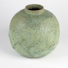Beatrice Wood volcanic glaze ceramic vase  	      	                  Mid 20th century, signed ''Beato'' (Beatrice Wood 1893 - 1998), the short circular neck over a globular body, of red clay, the exterior covered in rough-textured green - turquoise glaze, the interior glazed in glossy brown, 9.75'' H x 10'' Dia.