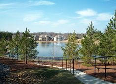 New neighborhoods feature amazing amenities, like this lake and walking trail.