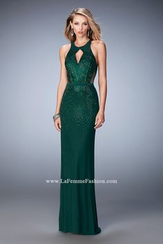 Showstopping net jersey gown from La Femme prom. It has a keyhole front and open back with rhinestones cascading down the bodice to the long skirt. View Size Chart