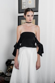 "Inject a statement crop for everyday sophistication. A delicate and feminine piece, the bow tie sleeves can be tied up or down. Pair the top with a pencil skirt or maxi skirt for a contemporary look. Details include a slight sheen to the fabric for evening glamour, hidden zip back closure and bustier padding. 100% Polyester Mix. Hidden zip back closure. Measurements Small / UK 6 measures 16"" PTP, 16"" waist, 10"" down. Medium / UK 8 measures 16.5"" PTP, 16.5"" waist, 10"" down. Large / UK…"