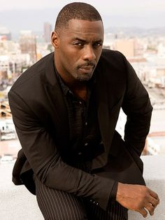 """Idris Elba....aka...""""faint""""....that should be how you address him at all times...just pass out in his presence. lol"""