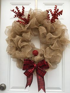 This adorable Christmas wreath is the perfect addition to your front door! This wreath is such a fun piece that will bring out the kid in all of your visitors during this wonderful Christmas season. This wreath is made on a wire wreath form, natural tan burlap deco mesh, red glittery