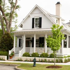 country/farmhouse look.Designed by Eric Moser, Sugarberry Cottage embodies all the notions of a historic Lowcountry cottage but with modern amenities. -- Photo by Jean Allsopp via Southern Living Cottage House Plans, Cottage Homes, Cottage Ideas, Small Cottage Plans, Cottage Porch, Cozy Cottage, Cottage Design, Cottage Style, White Cottage