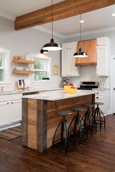 Chip and Joanna work a big island with tons of workspace into almost every kitchen. This one has room for eating, cooking and more, not to mention lots of texture and history thanks to the reclaimed wood used for the base.