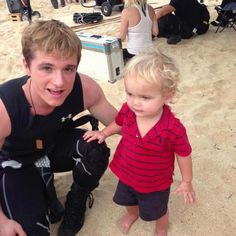 Josh Hutcherson with Jennifer Lawrence's nephew on the Catching Fire set. I just got visions of the end of Mockingjay!