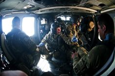 Staff Sgt. Erin Gibson reassures patients in the back of an 82nd Combat Aviation Brigade medevac helicopter while Spc. Bryan Heaston, maintains a close watch on security and safety in Logar province, Afghanistan, July 8, 2012. (Photo by SFC Eric Pahon)