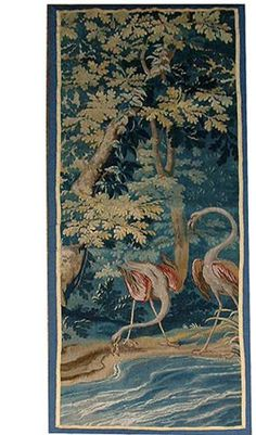 An 18th Century Flemish Verdure Tapestry Fragment depicting a pair of flamingos beside a stream in a lush forest setting