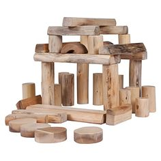 These gorgeous raw-look Tree Blocks from QToys feel great in the hand and showcase the natural grain of their eco-friendly plantation timber finished with beeswax.