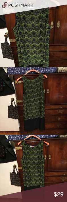 Green lacy dress Pretty dress, worn once and received lots of compliments. But I don't think it's my color and did not like the way it looked in pictures. There is a black section at the bottom with lacy detail.  Although it is a size 16, I think it fits more like a 14.  Unless you want it to be tight. Isaac Mizrahi Dresses Midi