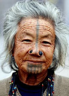 Northeast India | Apatani woman with traditional tattoos and nose plugs | © Monique Vos