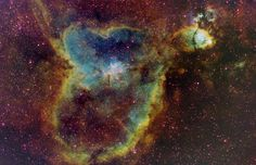 IC 1805: Light from the Heart   In fact, the nebular glow is often dominated by hydrogen atoms emitting light in only a small fraction of that broad region of the spectrum that we see as the color red. Adopting an artificial color scheme commonly used for narrow band images of emission nebulae, this beautifully detailed view shows the light from sulfur atoms in red hues, with hydrogen in green, and oxygen atoms in blue.   http://apod.nasa.gov/apod/ap040917.html