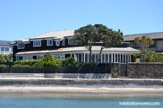 Not only does the home have incredible sea views but it sits right by the ocean. The exterior is stained in Wood X Foundry from Resene. http://www.habitatbyresene.co.nz/designer-captures-cape-cod-style
