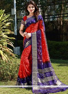 This red fancy fabric traditional saree add the sense of elegant and glamorous. The ethnic bandhej work within the dress adds a sign of beauty statement for the look. Comes with matching blouse. (Slig...
