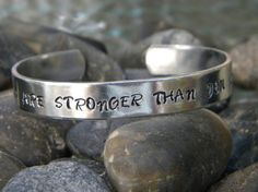 """On the outside a reminder, """"YOU ARE STRONGER THAN YOU KNOW"""" but on the inside """"F--K CANCER"""".   Inspirational gifts for cancer patients, survivors and their loved ones.  20% of profits from this campaign goes to cancer research.  Use code CANCERSUCKS at http://shop.purplepelicandesigns.com for free standard US shipping through 11/30/2013"""
