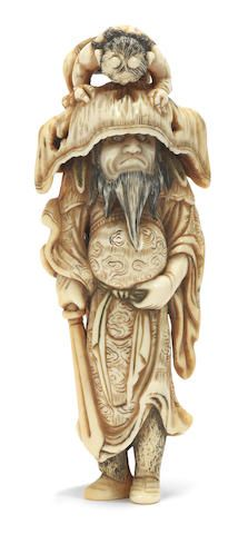 An ivory netsuke of Shoki and a demon Late 18th century