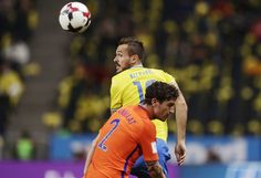 Emir Kujovic of Sweden and Daryl Janmaat of  Netherlands competes for the ball during the FIFA World Cup Qualifier between Sweden and Netherlands at Friends arena on September 6, 2016 in Solna, Sweden.