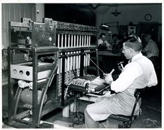 A technician builds a mechanical card sorter in the 1930s. We used mechanical sorters and tabulators from 1890 through the 1950 Census when computers began replacing them.