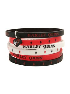 6 rubber bracelets with various Harley Quinn inspired designs and a small rubber heart charm.