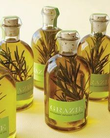 """Wedding Favors: Rosemary Olive Oil To create this Italian specialty, place a few snips of herbs in an empty bottle, pour in olive oil, cork, and seal with clip art. Materials: Specialty Bottle """"Boston"""" glass bottle with cork. Destination Wedding Favors, Edible Wedding Favors, Party Favors, Shower Favors, Wedding Programs, Diy Party, Party Gifts, Shower Invitations, Olive Oil Favors"""
