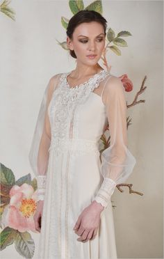Check out the gorgeous sleeves on this vintage-inspired wedding gown!
