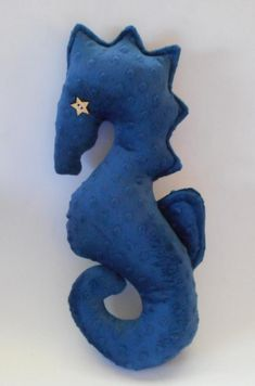 Navy blue seahorse pillow, nautical decor, nautical baby, nautical pillows, minky dot seahorse pillo Navy blue seahorse pillow stands 17 inches tall and is made from a cuddle minky dot fabric. Features outline stitching a. Nautical Baby Nursery, Nautical Pillows, Nautical Home, Mermaid Beach, Flower Pillow, Plush Animals, Dinosaur Stuffed Animal, Navy Blue, Coastal Living