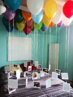 """Balloons - one for each year with picture. Doing this for my son's 18th birthday. I'm sure he'll be irritated but I'll get a good """"aww"""" moment! LOL!"""