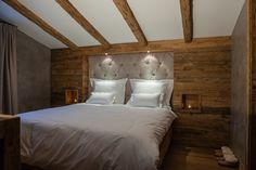 RUSTIC MEETS TRADITIONAL in this high-end European chalet. The tufted headboard recessed into the reclaimed wood wall paired with recessed nooks as end tables is awesome! Basement Flooring, Boutique, Jacuzzi, Wood Wall, End Tables, Your Space, Rustic, Interior Design, Nooks