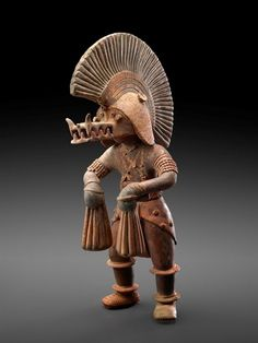 Dancer with Crocodile Helmet. Datec 300 B.C.–A.D. 300 Place of origin/Culture: Colima Medium: Earthenware with traces of polychrome pigment. - Andrew Ledford - Google+