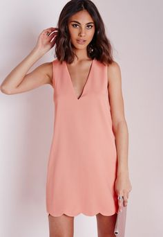 Work this fanciful shift dress this season in this dreamy blush hue. In chic crepe fabric this v neck, sleeveless beauty with scallop hem detail will give you a smokin' silhouette. Team with strappy nude heels and matching clutch for a fe. Blush Dresses, Dresses Uk, Cute Dresses, Short Dresses, Tent Dress, Dress Skirt, Akita, Bridesmaid Dresses Under 100, Bridesmaids