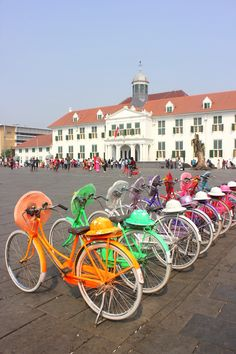 Colourful bicycles for rent in front of Taman Fatahillah Museum.