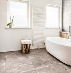 The Countryside collection from Garden State Tile has the striking and present neo-industrial cement-look, combined with a rural natural stone expression. A modern reinterpretation of a rustic stone floor – with a twist. Countryside is available in four natural colors to preserve the authenticity of design. Bathroom Design Inspiration, Rustic Stone, Stone Flooring, Natural Colors, Clawfoot Bathtub, Cement, Preserve, Authenticity, Countryside
