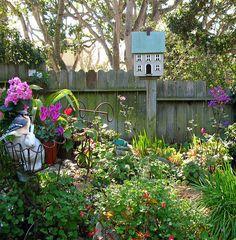 pretty garden and birdhouse