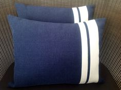 The fabulous rectangle cushions in classic navy blue with cream trim size 45 x 35 cm with feather inners
