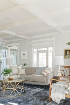 eclectic living room in SW Aloof Gray, light gray #paint