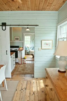 Beach Cottage Dining Room with Aqua Planked Walls and White Barn Door !