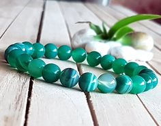 Check out this item in my Etsy shop https://www.etsy.com/listing/491263104/8mm-green-striped-agate-bracelet-green